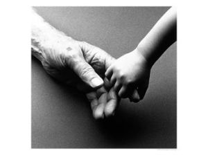 428873~Adult-hand-holding-little-child-s-hand-Posters