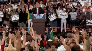 Trump hands up